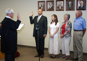 Commissioner Steve Harding was sworn into office in July 2008. Pictured (left to right) Judge John Brown administering the Oath of Office, Commissioner Harding, wife Monica, and parents Pat and Homer Harding.