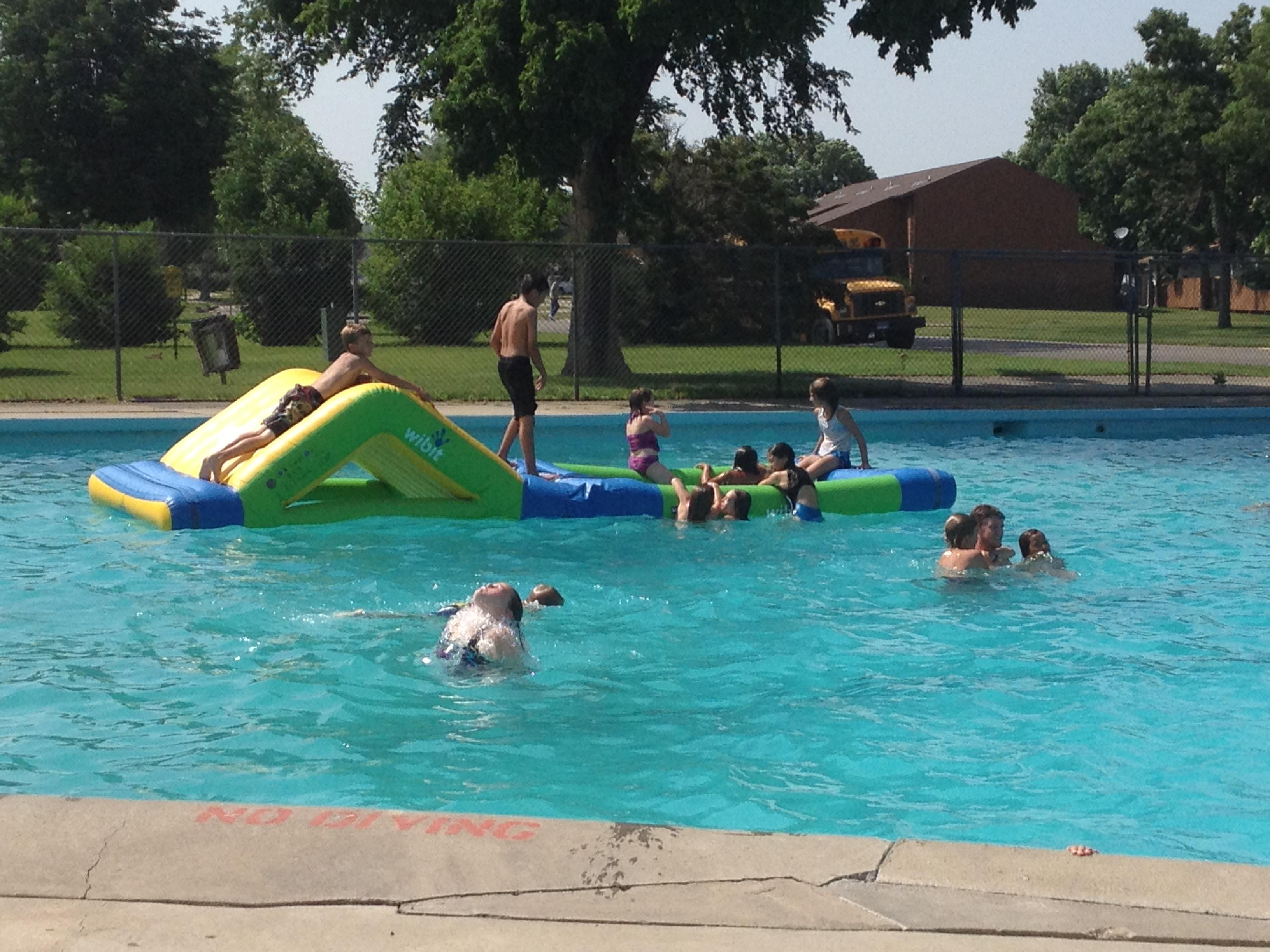 Children Playing In A Pool On Slide