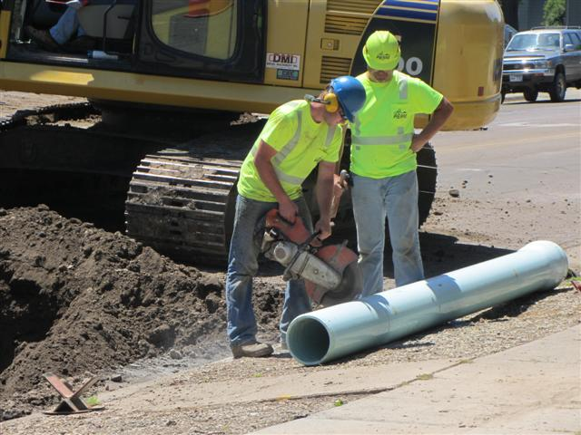 Water crews cut water main to size during a replacement project on Capitol. June 13, 2012