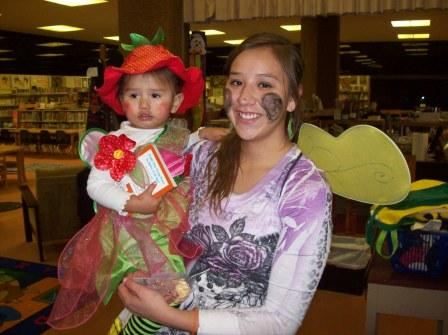 A Parent and her Kid in Costume